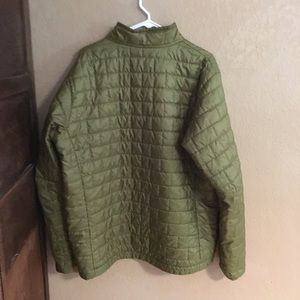 Men's Nano Puff jacket in green.